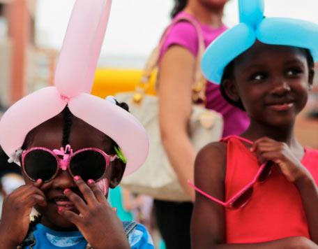Children wearing balloon hats.